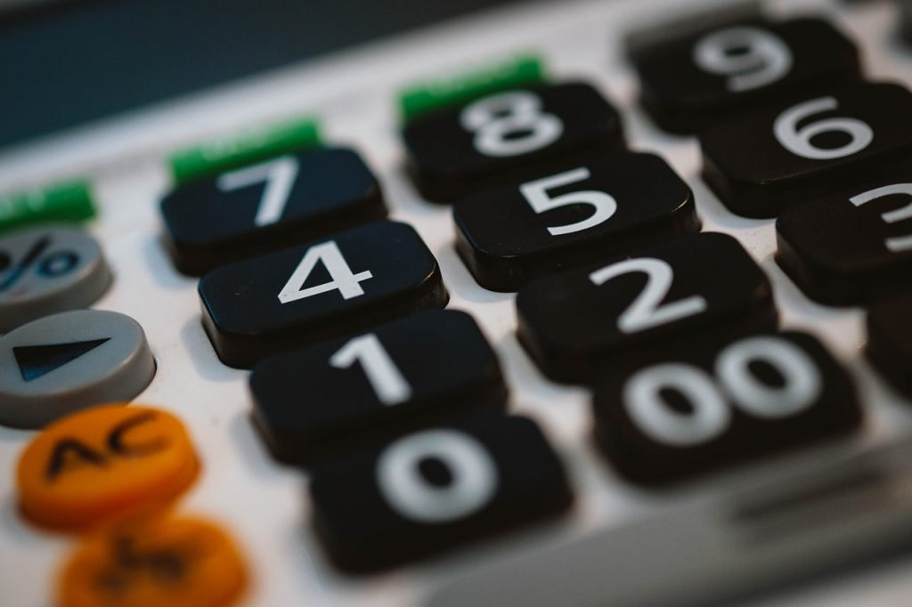 image of calculator to support article on how much should a small business spend on marketing